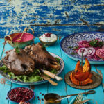 Turkish lambs head with cucumber and pomegranate raita, beetroot hummus and grilled pumpkin