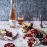 Summer cheese and charcuterie platter with strawberry and rose chutney, fig jam, sour dough bread and grapes